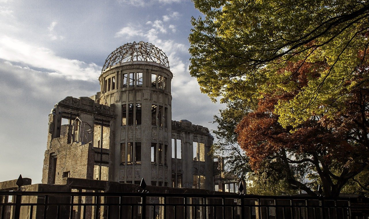 """<span style=""""color: #ffffff;"""">The A-Bomb Dome is the skeletal ruins of the former Hiroshima Prefectural Industrial Promotion Hall.<br />It is the building closest to the hypocenter of the nuclear bomb that remained at least partially standing.</span>"""