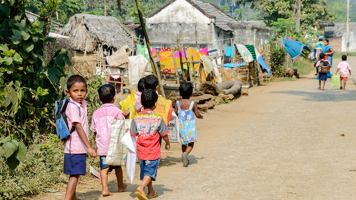 School children walking in a village after school in Angul district of Odisha state in india. Image: Abhishek Bagrodia / Shutterstock.com